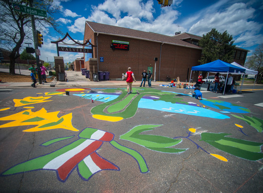 New Neighborhood Mural painted by Athmar Park community members outside Valverde Elementary