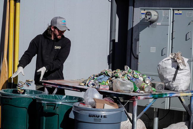 Jarred sorts through the recycling