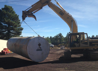 Water catchment tank getting moved into place