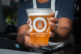 ilili Box employee holding a cold beer