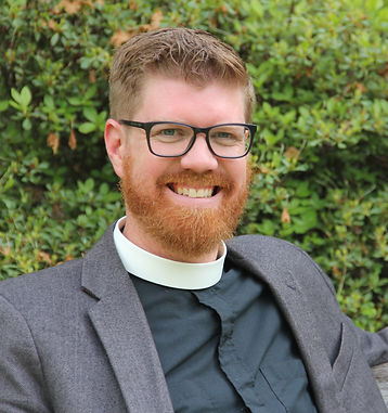 A photo of the Reverend Steve Pankey.  Steve has blonde hair and a beard and is smiling.