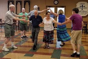 The English Country Dance group, enjoying a traditional dance