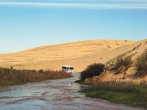 dune-rider-driving-through-te-paki-strea