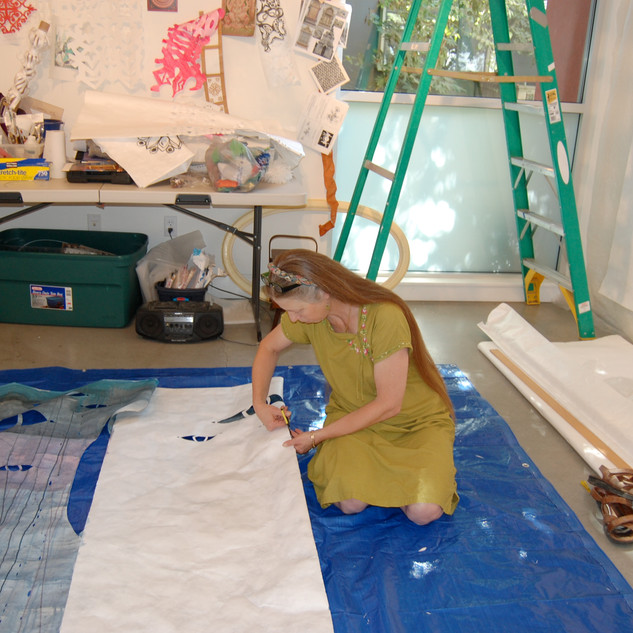 "The artist works on the ""Sorrow and Loss"" panel."