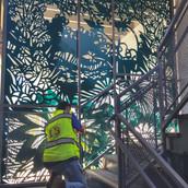 """Our Garden""  Installations in progress in the Pence Gallery courtyard, Davis, CA. Waterjet cut alluminum."