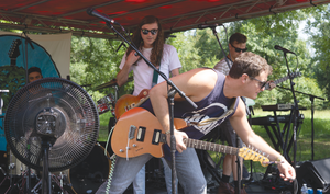 Atlas Road Crew guitarist interacts with the crowd during their performance on Aug. 25.