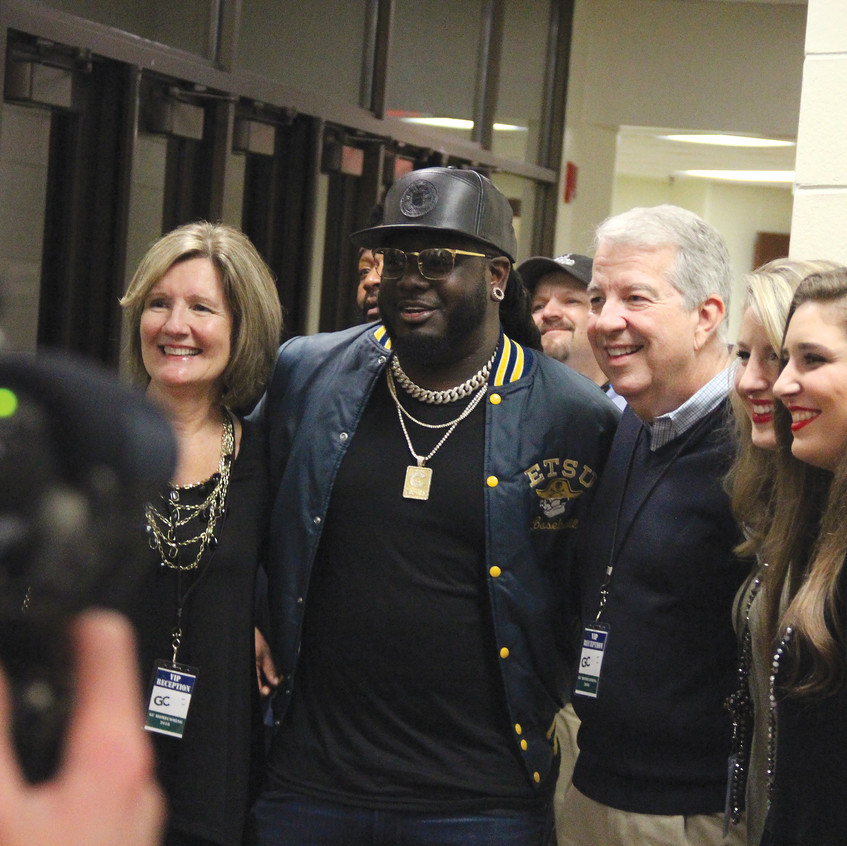 T-Pain and President Dorman pose for a picture.