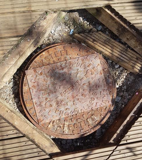 Camouflaged Manhole