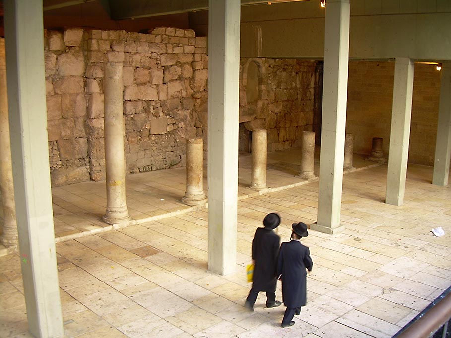Two Orthodox Jewish men walking through remains of the ancient Cardo, Jerusalem, 2009