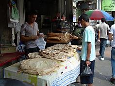 Traditional flat bread in outdoor market, Ramallah, 2009