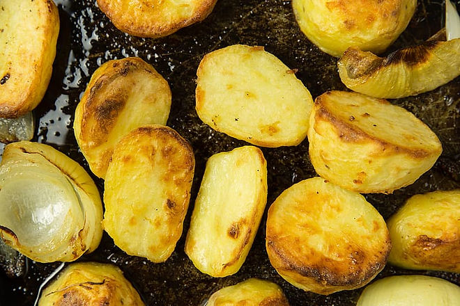 roast-potatoes-and-onions-in-baking-tray