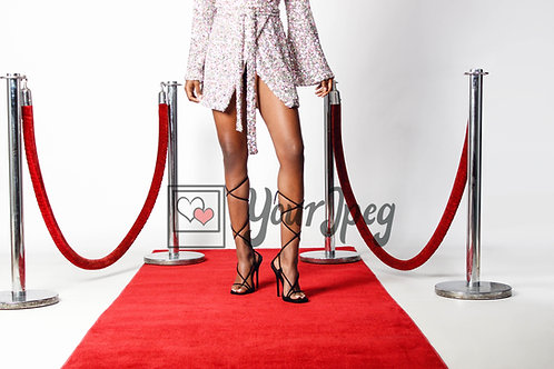 Woman Showing Off Shoes On Red Carpet