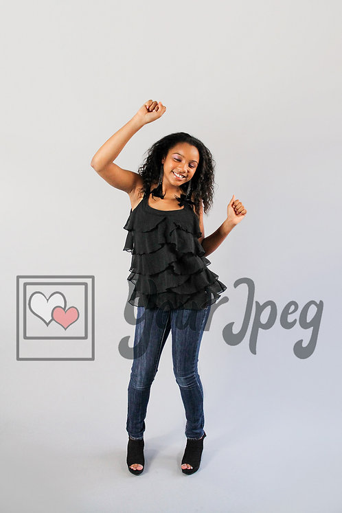 Tween girl dancing arms in air