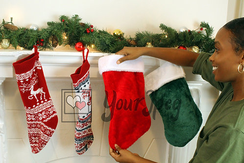 Woman adjusting up Christmas stocking