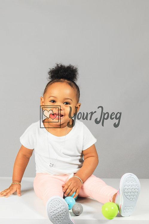 Toddler Smiling While Sitting #5