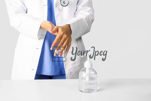 Female Doctor Using Hand Sanitizer #4