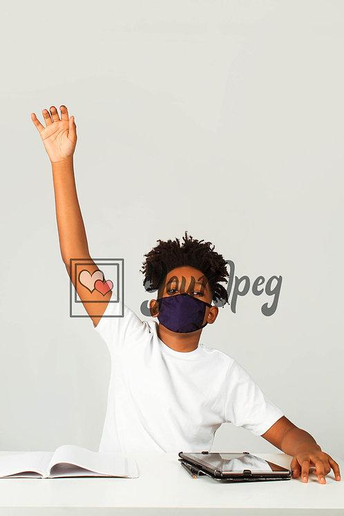 Teenage boy raising hand