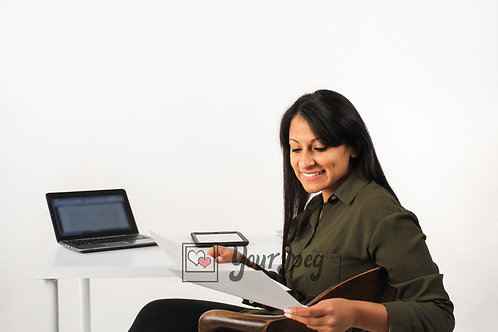 Woman Smiling While Looking At Papers At Desk