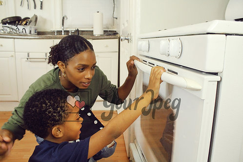 Mom and son looking in oven 1
