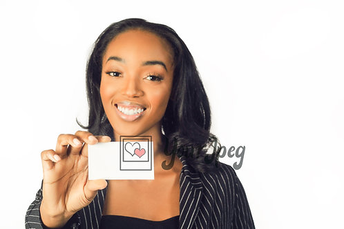 Woman In Suit Holding Up White Card Smiling