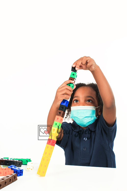 Boy Playing With Blocks While Wearing Mask