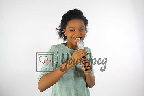 Tween girl singing into microphone