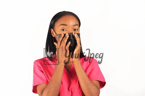 Female Nurse Adjusting Black Face Mask At Nose
