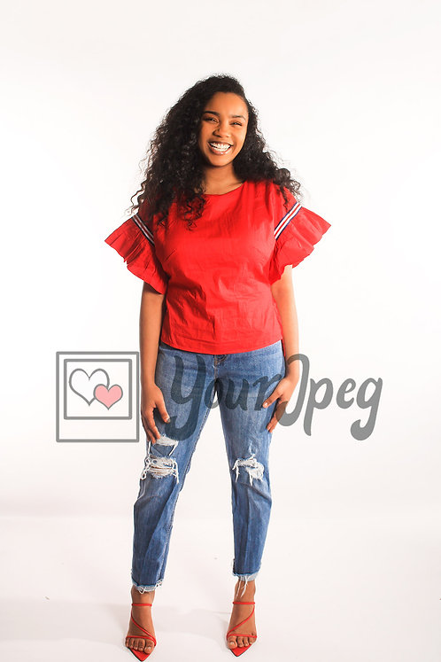 Woman laughing wearing jeans