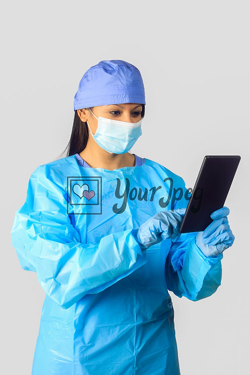 Female Nurse In Protective Equipment Holding Tablet