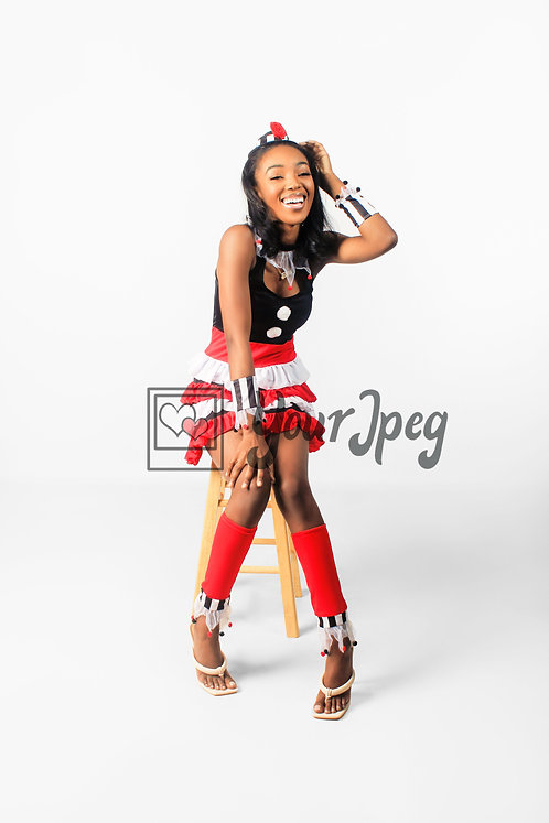 Woman Modeling In Costume Sitting On Stool Smiling