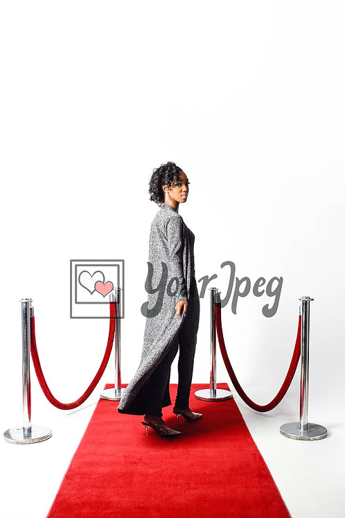 Woman Posing on Red Carpet Looking Forward Over Her Shoulder