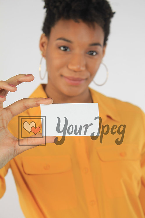 Woman holding up blank card to camera