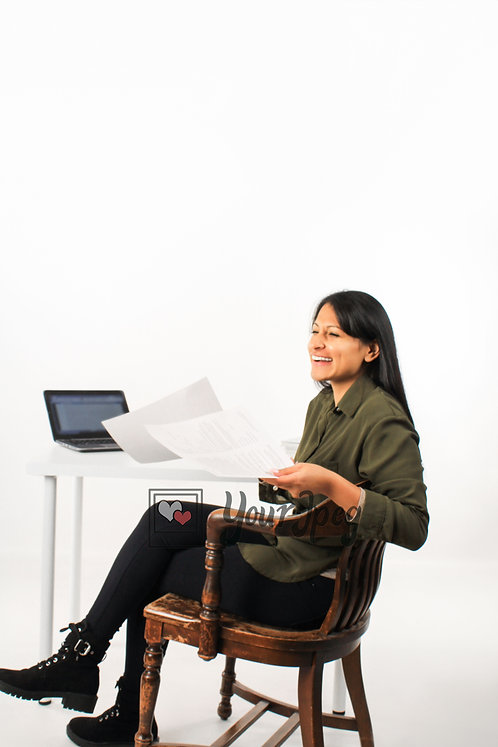 Woman Holding Papers While Sitting At Desk Smiling Full Body