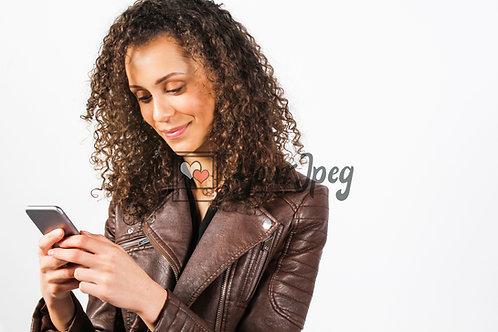 Woman looking at phone texting