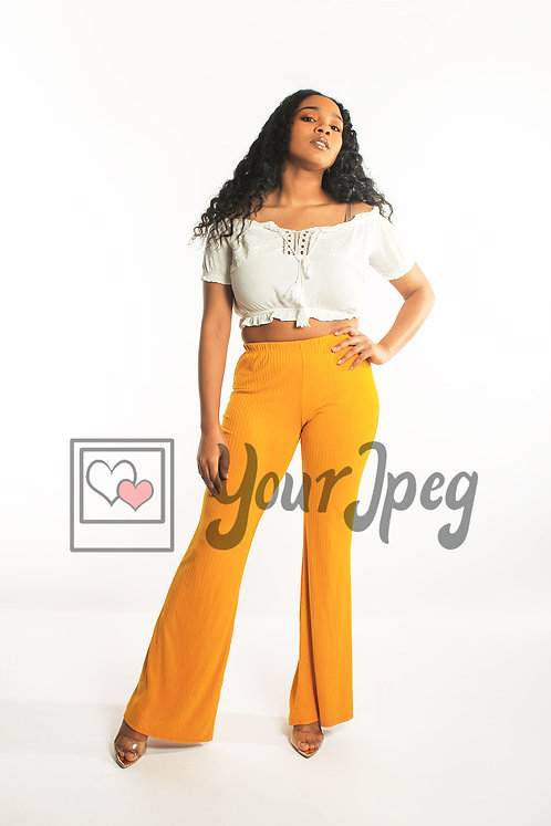 Woman looking up posing in yellow pants