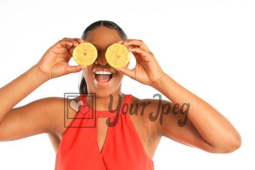 Woman holding lemons up