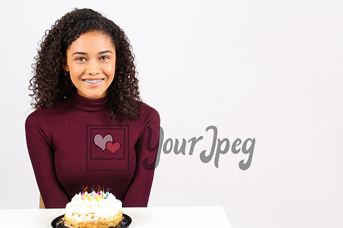 Teen girl with birthday cake looking and smiling