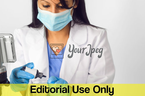 Female Doctor Wearing Mask While Putting Drops On Microscope Slide #1