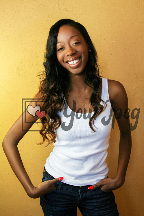 Young woman laughing with hands in jeans pocket