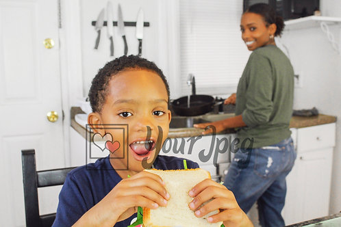 Boy smiling holding sandwich 2