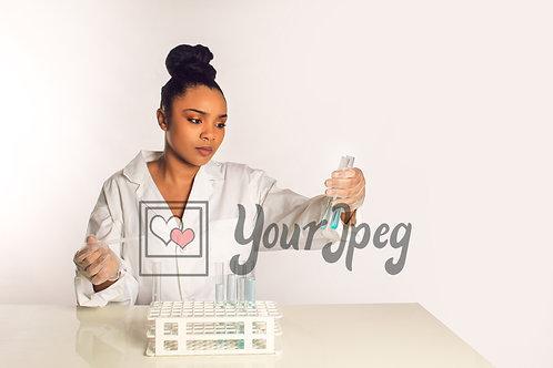 Female scientist comparing a liquid sample