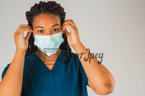 Female Nurse Putting On Mask #2