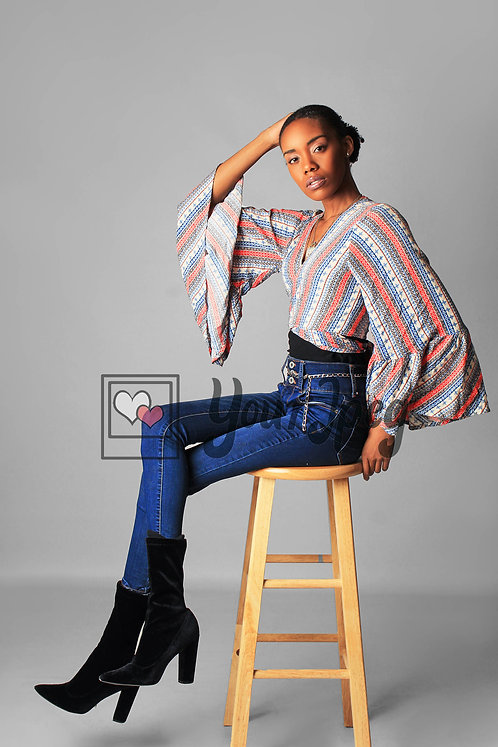 Model Sitting On Stool At An Angle