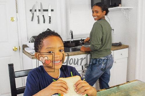 Boy smiling holding sandwich 4