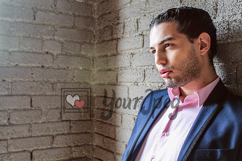 Profile Closeup of man leaning against wall