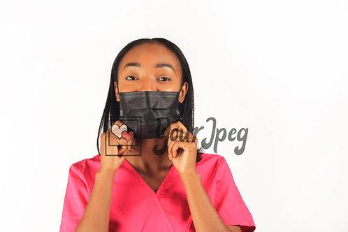Female Nurse Adjusting Face Mask At Chin