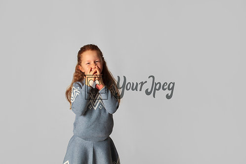 Young Girl With Hands Over Mouth