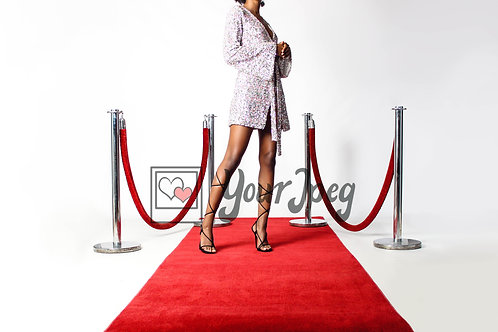 Woman Posing On Red Carpet Holding Jacket