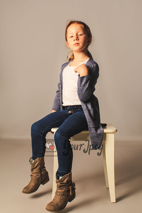 Girl Sitting On Table Modeling At An Angle