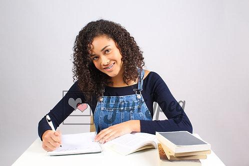 Teenage girl studying and smiling